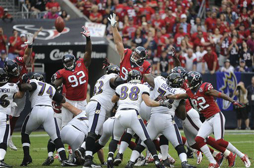 Houston Texans defensive end J.J. Watt &#40;99&#41; and Earl Mitchell &#40;92&#41; try to block a field goal by the Baltimore Ravens during the first quarter of an NFL football game Sunday, Oct. 21, 2012, in Houston. &#40;AP Photo&#47;Dave Einsel&#41; <span class=meta>(AP Photo&#47; Dave Einsel)</span>