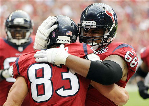 Houston Texans Kevin Walter &#40;83&#41; and Ryan Harris &#40;68&#41; celebrate a touchdown against the Baltimore Ravens during the first quarter of an NFL football game on Sunday, Oct. 21, 2012, in Houston. &#40;AP Photo&#47;Dave Einsel&#41; <span class=meta>(AP Photo&#47; Dave Einsel)</span>