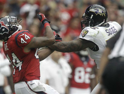Baltimore Ravens Terrell Suggs, right, defends against Houston Texans running back Ben Tate &#40;44&#41; during the first quarter of an NFL football game Sunday, Oct. 21, 2012, in Houston. &#40;AP Photo&#47;Patric Schneider&#41; <span class=meta>(AP Photo&#47; Patric Schneider)</span>
