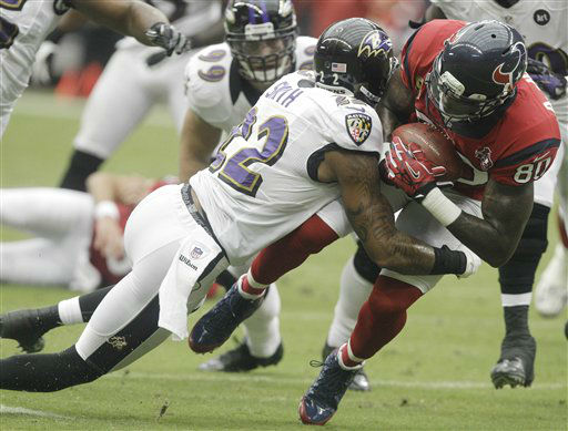 Baltimore Ravens defensive back Jimmy Smith &#40;22&#41; tackles Houston Texans wide receiver Andre Johnson &#40;80&#41; during the first quarter of an NFL football game Sunday, Oct. 21, 2012, in Houston. &#40;AP Photo&#47;Patric Schneider&#41; <span class=meta>(AP Photo&#47; Patric Schneider)</span>