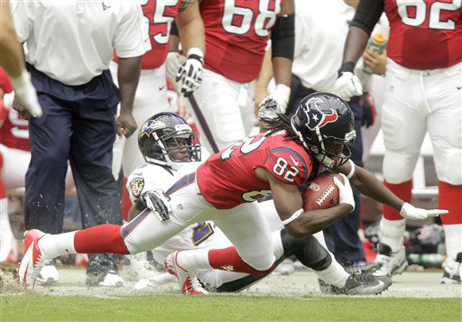 Baltimore Ravens defensive back Chykie Brown brings down Houston Texans wide receiver Keshawn Martin &#40;82&#41; during the first quarter of an NFL football game Sunday, Oct. 21, 2012, in Houston. &#40;AP Photo&#47;Patric Schneider&#41; <span class=meta>(AP Photo&#47; Patric Schneider)</span>
