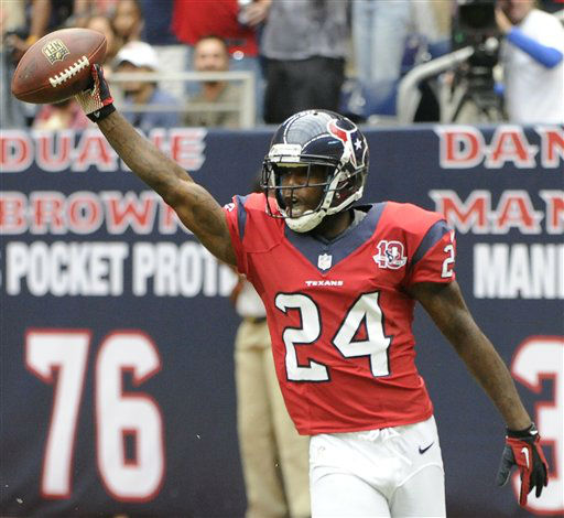 Houston Texans cornerback Johnathan Joseph &#40;24&#41; celebrates after returning an interception for a touchdown against the Baltimore Ravens during the first quarter of an NFL football game Sunday, Oct. 21, 2012, in Houston. &#40;AP Photo&#47;Dave Einsel&#41; <span class=meta>(AP Photo&#47; Dave Einsel)</span>