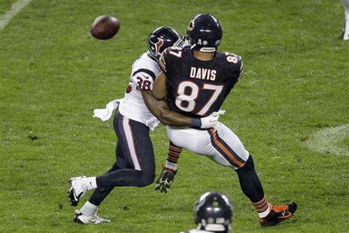 Chicago Bears tight end Kellen Davis &#40;87&#41; fumbles as he is tackled by Houston Texans safety Danieal Manning &#40;38&#41; during the first half of an NFL football game, Sunday, Nov. 11, 2012, in Chicago. The Texans recovered the ball. &#40;AP Photo&#47;Kiichiro Sato&#41; <span class=meta>(Photo&#47;Kiichiro Sato)</span>