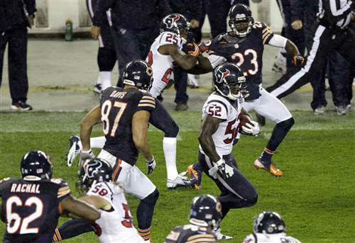 Houston Texans linebacker Tim Dobbins &#40;52&#41; runs after recovering a fumble by Chicago Bears tight end Kellen Davis &#40;87&#41; during the first half of an NFL football game, Sunday, Nov. 11, 2012, in Chicago. Davis made the tackle on Dobbins. &#40;AP Photo&#47;Kiichiro Sato&#41; <span class=meta>(Photo&#47;Kiichiro Sato)</span>