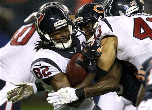 Houston Texans wide receiver Keshawn Martin &#40;82&#41; tackled by Chicago Bears defensive back Zack Bowman during the first half an NFL football game, Sunday, Nov. 11, 2012,in Chicago. &#40;AP Photo&#47;Nam Y. Huh&#41; <span class=meta>(Photo&#47;Nam Y. Huh)</span>