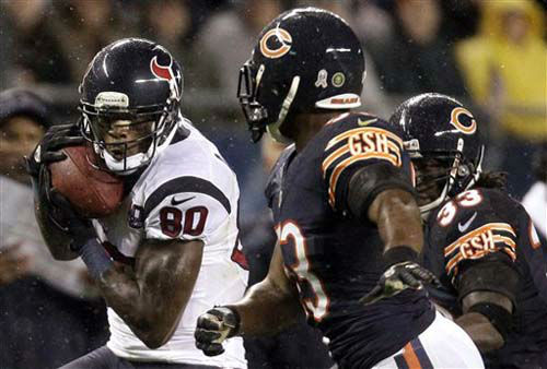 Houston Texans wide receiver Andre Johnson &#40;80&#41; makes a catch in front of Chicago Bears linebacker Nick Roach, center, and cornerback Charles Tillman &#40;33&#41; during the first half an NFL football game in Chicago, Sunday, Nov. 11, 2012. &#40;AP Photo&#47;Nam Y. Huh&#41; <span class=meta>(Photo&#47;Nam Y. Huh)</span>