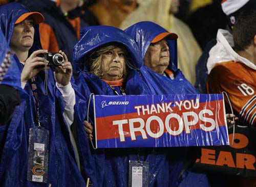 "<div class=""meta ""><span class=""caption-text "">Fans hold up signs supporting troops during the first half an NFL football game between the Chicago Bears and Houston Texans as part of the NFL's Salute to Service campaign on Veterans Day, Sunday, Nov. 11, 2012, in Chicago. (AP Photo/Nam Y. Huh) (Photo/Nam Y. Huh)</span></div>"