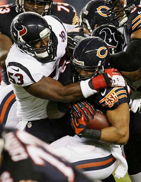 "<div class=""meta ""><span class=""caption-text "">Chicago Bears running back Matt Forte, right, is tackled by Houston Texans linebacker Bradie James (53) during the first half an NFL football game, Sunday, Nov. 11, 2012, in Chicago. (AP Photo/Charles Rex Arbogast) (Photo/Charles Rex Arbogast)</span></div>"