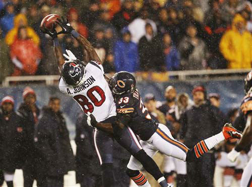 Chicago Bears cornerback Charles Tillman &#40;33&#41; breaks up a pass intended for Houston Texans wide receiver Andre Johnson &#40;80&#41;in the first half an NFL football game in Chicago, Sunday, Nov. 11, 2012. &#40;AP Photo&#47;Charles Rex Arbogast&#41; <span class=meta>(Photo&#47;Charles Rex Arbogast)</span>