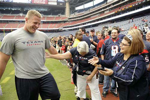 "<div class=""meta ""><span class=""caption-text "">Houston Texans defensive end J.J. Watt, left, greets fans before an NFL football game against the Jacksonville Jaguars Sunday, Nov. 18, 2012, in Houston. (AP Photo/Dave Einsel) (Photo/Dave Einsel)</span></div>"
