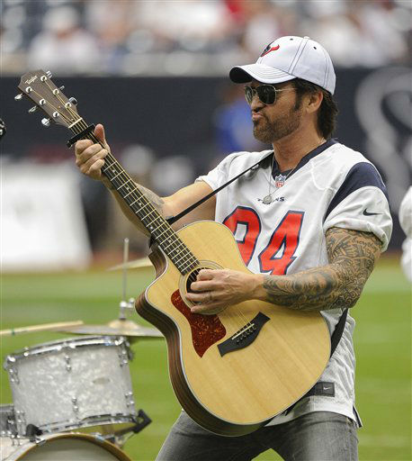 "<div class=""meta ""><span class=""caption-text "">Billy Ray Cyrus performs during halftime of an NFL football game between the Miami Dolphins and Houston Texans, Sunday, Sept. 9, 2012, in Houston. (AP Photo/Dave Einsel) (AP Photo/ Dave Einsel)</span></div>"