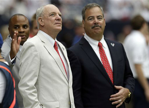 Houston Texans owner Bob McNair, left, and his son Cal McNair watch from the sidelines before an NFL football game against the Miami Dolphins Sunday, Sept. 9, 2012, in Houston. &#40;AP Photo&#47;David J. Phillip&#41; <span class=meta>(AP Photo&#47; David J. Phillip)</span>
