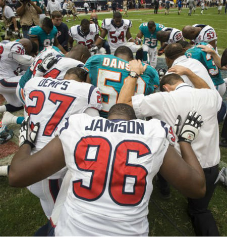 Members of the Miami Dolphins and Houston Texans pause for a prayer after an NFL football game, Sunday, Sept. 9, 2012, in Houston. The Texans beat the Dolphins 30-10. &#40;AP Photo&#47;Dave Einsel&#41; <span class=meta>(AP Photo&#47; Dave Einsel)</span>