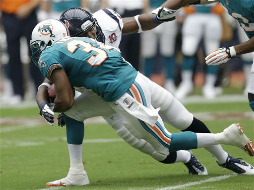 Miami Dolphins running back Marcus Thigpen &#40;34&#41; is stopped by Houston Texans linebacker Mister Alexander on the kickoff return in the first quarter of an NFL football game on Sunday, Sept. 9, 2012, in Houston. &#40;AP Photo&#47;David J. Phillip&#41; <span class=meta>(AP Photo&#47; David J. Phillip)</span>