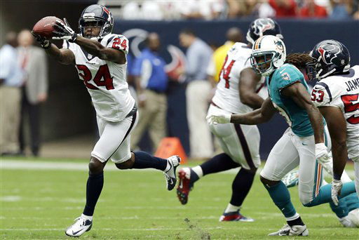 Houston Texans cornerback Johnathan Joseph intercepts a pass as Miami Dolphins wide receiver Legedu Naanee watchesn in the second quarter of an NFL football game, Sunday, Sept. 9, 2012, in Houston. &#40;AP Photo&#47;David J. Phillip&#41; <span class=meta>(AP Photo&#47; David J. Phillip)</span>