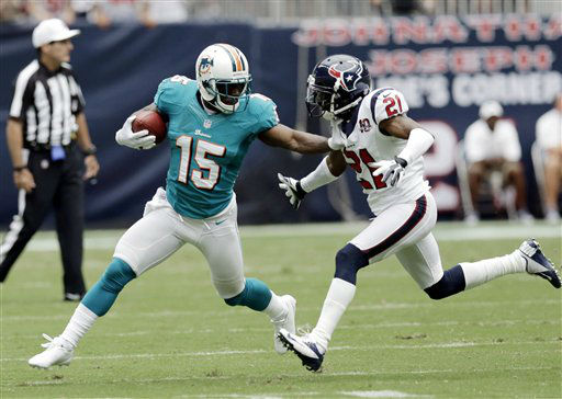 Miami Dolphins wide receiver Davone Bess &#40;15&#41; and Houston Texans defensive back Brice McCain &#40;21&#41; in the second quarter of an NFL football game Sunday, Sept. 9, 2012, in Houston. &#40;AP Photo&#47;David J. Phillip&#41; <span class=meta>(AP Photo&#47; David J. Phillip)</span>