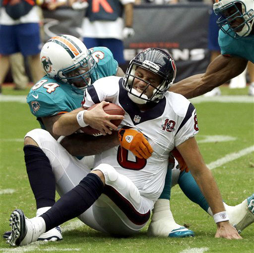 Houston Texans quarterback Matt Schaub &#40;8&#41; is sacked by Miami Dolphins defensive tackle Randy Starks &#40;94&#41; and linebacker Cameron Wake, right, in the second quarter of an NFL football game, Sunday, Sept. 9, 2012, in Houston. &#40;AP Photo&#47;David J. Phillip&#41; <span class=meta>(AP Photo&#47; David J. Phillip)</span>