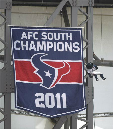 Houston Texans mascot &#34;Toro&#34; rappels from the top of Reliant Stadium as a banner unfurls honoring the Texans&#39; division championship during the 2011 season before an NFL football game against the Miami Dolphins, Sunday, Sept. 9, 2012, in Houston. &#40;AP Photo&#47;Dave Einsel&#41; <span class=meta>(AP Photo&#47; Dave Einsel)</span>