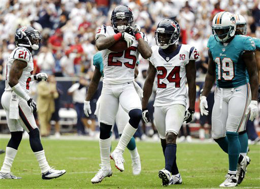 Houston Texans cornerback Kareem Jackson &#40;25&#41; celebrates after intercepting a pass against the Miami Dolphins in the second quarter of an NFL football game, Sunday, Sept. 9, 2012, in Houston. &#40;AP Photo&#47;Eric Gay&#41; <span class=meta>(AP Photo&#47; Eric Gay)</span>