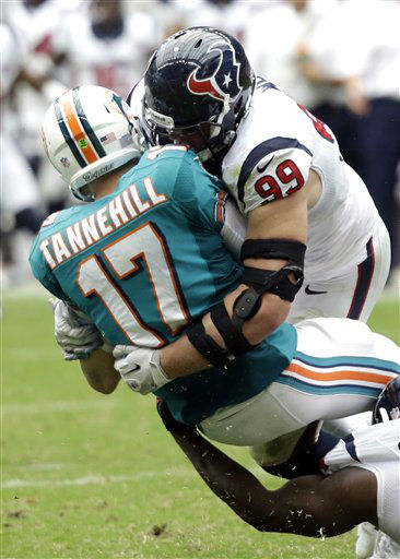 Houston Texans defensive end J.J. Watt &#40;99&#41; sacks Miami Dolphins quarterback Ryan Tannehill &#40;17&#41; in the third quarter of an NFL football game Sunday, Sept. 9, 2012, in Houston. &#40;AP Photo&#47;Eric Gay&#41; <span class=meta>(AP Photo&#47; Eric Gay)</span>