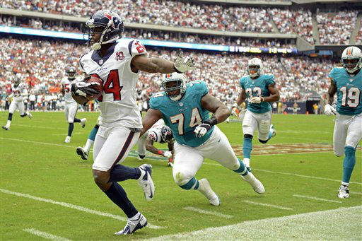 Houston Texans cornerback Johnathan Joseph &#40;24&#41; returns an interception as Miami Dolphins guard John Jerry &#40;74&#41; dives to tackle him in the second quarter of an NFL football game, Sunday, Sept. 9, 2012, in Houston. &#40;AP Photo&#47;Dave Einsel&#41; <span class=meta>(AP Photo&#47; Dave Einsel)</span>