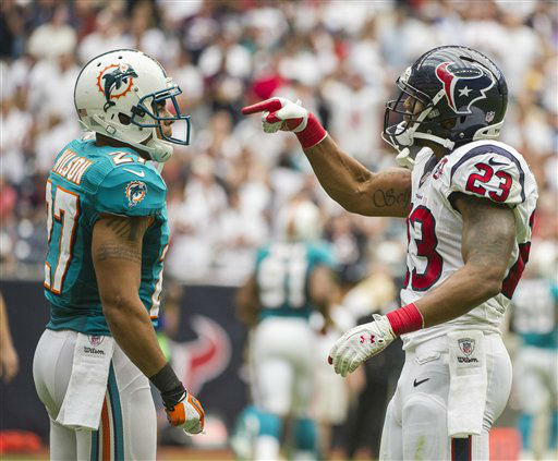 Houston Texans&#39; Arian Foster &#40;23&#41; and Miami Dolphins&#39; Jimmy Wilson &#40;27&#41; exchange words during an NFL football game, Sunday, Sept. 9, 2012, in Houston. The Texans beat the Dolphins 30-10. &#40;AP Photo&#47;Dave Einsel&#41; <span class=meta>(AP Photo&#47; Dave Einsel)</span>