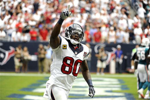 Houston Texans wide receiver Andre Johnson &#40;80&#41; celebrates a touchdown catch against the Miami Dolphins in the second quarter of an NFL football game Sunday, Sept. 9, 2012, in Houston. &#40;AP Photo&#47;Dave Einsel&#41; <span class=meta>(AP Photo&#47; Dave Einsel)</span>
