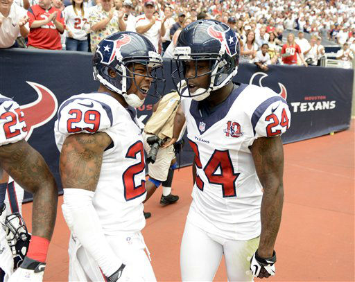 Houston Texans cornerback Johnathan Joseph &#40;24&#41; celebrates a pass interception with teammate  Glover Quin &#40;29&#41; in the second quarter of an NFL football game against the Miami Dolphins Sunday, Sept. 9, 2012, in Houston. &#40;AP Photo&#47;Dave Einsel&#41; <span class=meta>(AP Photo&#47; Dave Einsel)</span>