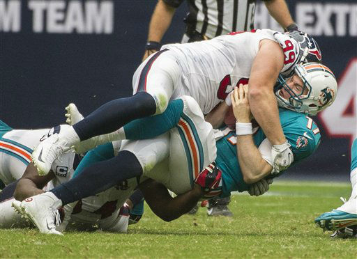 Houston Texans&#39; J.J. Watt &#40;99&#41; sacks Miami Dolphins&#39; Ryan Tannehill &#40;17&#41; during an NFL football game, Sunday, Sept. 9, 2012, in Houston. The Texans beat the Dolphins 30-10. &#40;AP Photo&#47;Dave Einsel&#41; <span class=meta>(AP Photo&#47; Dave Einsel)</span>