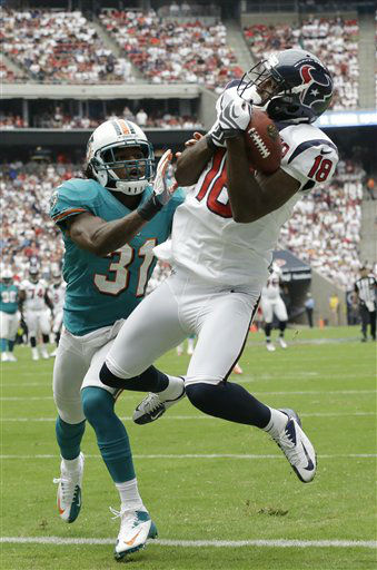 Houston Texans wide receiver Lestar Jean &#40;18&#41; hauls in the ball in the end zone under pressure from Miami Dolphins defensive back Richard Marshall &#40;31&#41; in the first quarter of an NFL football game on Sunday, Sept. 9, 2012, in Houston. Jean lost the ball after hitting the ground, so what would have been a touchdown was called an incomplete pass. &#40;AP Photo&#47;Eric Gay&#41; <span class=meta>(AP Photo&#47; Eric Gay)</span>