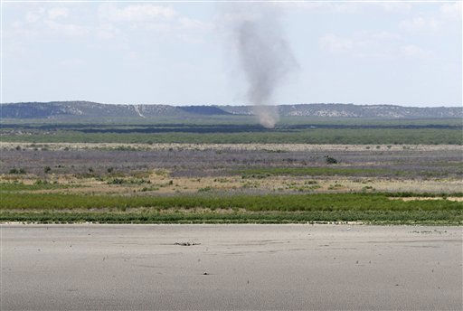 The dried up bed at O.C. Fisher Lake is seen in the foreground as a dust devil develops in the distance Wednesday, Aug. 3, 2011, in San Angelo, Texas. According to state park officials, long periods of 100 degree plus days and lack of rain in the drought-stricken region over the past few years has nearly dried out the man made reservoir that once spanned over 5400 acres. &#40;AP Photo&#47;Tony Gutierrez&#41; <span class=meta>(AP Photo&#47; Tony Gutierrez)</span>
