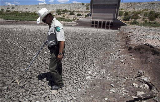"<div class=""meta image-caption""><div class=""origin-logo origin-image ""><span></span></div><span class=""caption-text"">Texas State Park police officer Thomas Bigham walks on the dried out bed of  O.C. Fisher Lake Wednesday, Aug. 3, 2011, in San Angelo, Texas. According to state park officials, long periods of 100 degree plus days and lack of rain in the drought-stricken region over the past few years has nearly dried out the man made reservoir that once spanned over 5400 acres. (AP Photo/Tony Gutierrez)(AP Photo/Tony Gutierrez) (AP Photo/ Tony Gutierrez)</span></div>"