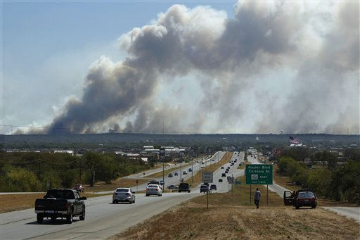A series of large wildfires as seen heading east approaching Bastrop, Texas  on Highway 71 Monday, Sep. 5, 2011.  A roaring wildfire raced unchecked Monday through rain-starved farm and ranchland in Texas, destroying nearly 500 homes during a rapid advance fanned in part by howling winds from the remnants of Tropical Storm Lee.   &#40;AP Photo&#47;Erich Schlegel&#41; <span class=meta>(AP Photo&#47; Erich Schlegel)</span>