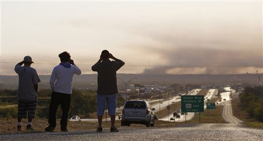 Smoke from a wildfire hangs in the sky, Tuesday, Sept. 6, 2011, in Bastrop, Texas. Officials hope that calmer winds Tuesday will help firefighters battling a wildfire that has destroyed nearly 500 homes in Central Texas and forced thousands of residents to evacuate to shelters to avoid the blaze. &#40;AP Photo&#47;Eric Gay&#41; <span class=meta>(AP Photo&#47; Eric Gay)</span>