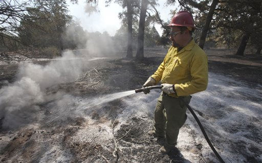 Wildland firefighter Jayan Palecek from the Sequoia National Forest in California  douses a hot spot on the fire near Bastrop, Texas, Friday, Sept. 9, 2011.  &#40;AP Photo&#47;LM Otero&#41; <span class=meta>(AP Photo&#47; LM Otero)</span>