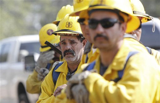 A fresh team of firefighters just arrived from the Sequoia National Forest in California line up to march in and  douses hot spots on the fire near Bastrop, Texas, Friday, Sept. 9, 2011.   &#40;AP Photo&#47;LM Otero&#41; <span class=meta>(AP Photo&#47; LM Otero)</span>