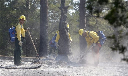 A fresh team of firefighters that just arrived from the Sequoia National Forest in California work hot spots on the fire near Bastrop, Texas, Friday, Sept. 9, 2011.  Texas is suffering its worst wildfire outbreak in state history. The Bastrop-area fire has been the largest of nearly 190 wildfires the forest service says erupted this week, leaving nearly 1,700 homes statewide in charred ruins, killing four people and forcing thousands of people to evacuate.   &#40;AP Photo&#47;LM Otero&#41; <span class=meta>(AP Photo&#47; LM Otero)</span>