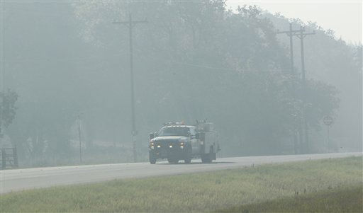 "<div class=""meta ""><span class=""caption-text "">near Bastrop, Texas, Friday, Sept. 9, 2011.  As the Texas wildfire season drags on, Texas firefighters are feeling the strain.  (AP Photo/LM Otero) (AP Photo/ LM Otero)</span></div>"