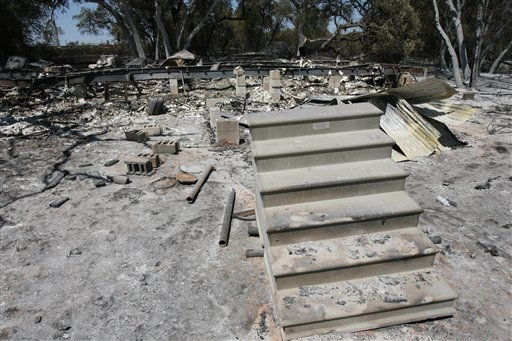"<div class=""meta ""><span class=""caption-text "">Stairs sit in front of a home destroyed by wildfires Friday Sept. 9, 2011 near Whitney, Texas. Over 500 acres of land burned including six homes. (AP Photo/Waco Tribune-Herald, Duane A. Laverty) (AP Photo/ Duane A. Laverty)</span></div>"