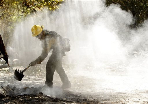 Tommy Ratto, a fire fighter from the Lassen National Forest in Calif., team cleans up a hot spot after the destructive wildfire in Bastrop, Texas, Sept. 10, 2011. Officials in Texas say fire crews are making progress fighting a massive Texas wildfire but concerns about hotspots are keeping thousands of residents in the Bastrop area from returning home. &#40;AP Photo&#47;Eric Schlegel - POOL&#41; <span class=meta>(AP Photo&#47; ERICH SCHLEGEL)</span>