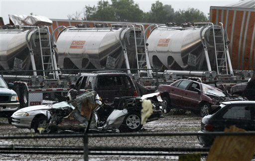 Destroyed vehicles sit in a Kenworth trailer lot after a tornado that swept through the area toppling many of the trailers on the lot Tuesday, April 3, 2012, in Lancaster, Texas. Tornadoes tore through the Dallas area Tuesday, peeling roofs off homes, tossing big-rig trucks into the air and leaving flattened tractor trailers strewn along highways and parking lots.  &#40;AP Photo&#47;Tony Gutierrez&#41; <span class=meta>(AP Photo&#47; Tony Gutierrez)</span>
