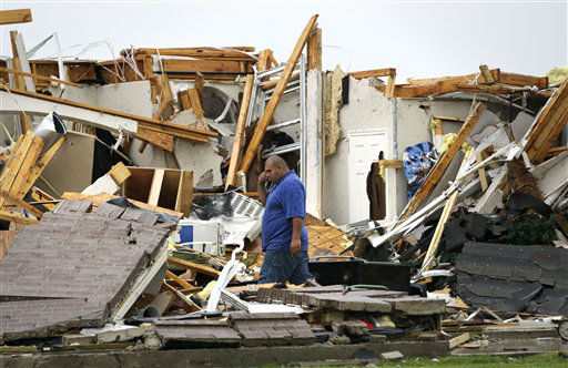 Juan Ventura stands inside what remains of his home as he talks with his father on his mobile phone Tuesday, April 3, 2012, in Forney, Texas. Ventura said that no one was home when the storm hit. &#40;AP Photo&#47;Tony Gutierrez&#41; <span class=meta>(AP Photo&#47; Tony Gutierrez)</span>