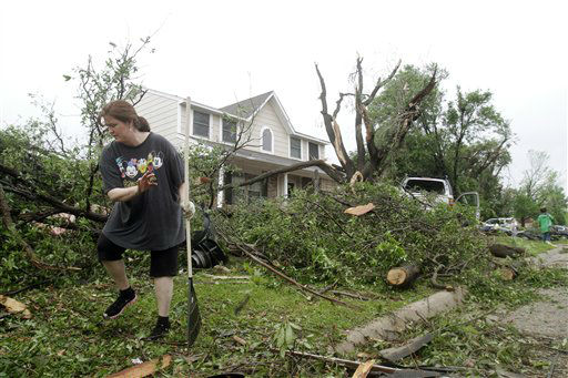 "<div class=""meta image-caption""><div class=""origin-logo origin-image ""><span></span></div><span class=""caption-text"">Angela Montgomery helps clean her neighbors' yards after a tornado swept through the Arlington, Texas neighborhood Tuesday, April 3, 2012. A violent storm spawning tornadoes touched down in the Dallas-Fort Worth area Tuesday. (AP Photo/Kim Johnson Flodin) (AP Photo/ Kim Johnson Flodin)</span></div>"