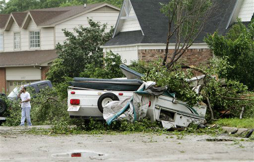 A damaged trailer remains in the street after a tornado swept through the Arlington, Texas Tuesday, April 3, 2012. A violent storm spawning tornadoes touched down in the Dallas-Fort Worth area Tuesday. &#40;AP Photo&#47;Kim Johnson Flodin&#41; <span class=meta>(AP Photo&#47; Kim Johnson Flodin)</span>