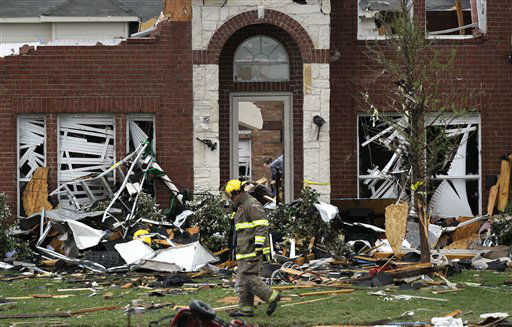 "<div class=""meta ""><span class=""caption-text "">A Forney firefighter walks in front of a home that was damaged after a tornado swept through the area Tuesday, April 3, 2012, in Forney, Texas. Tornadoes tore through the Dallas area Tuesday, peeling roofs off homes, tossing big-rig trucks into the air and leaving flattened tractor trailers strewn along highways and parking lots. (AP Photo/Tony Gutierrez) (AP Photo/ Tony Gutierrez)</span></div>"