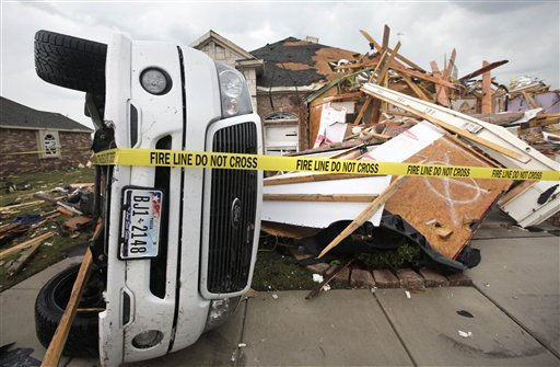 A toppled truck sits in a driveway of a completely destroyed home after a tornado swept through the area Tuesday, April 3, 2012, in Forney, Texas. Tornadoes tore through the Dallas area Tuesday, peeling roofs off homes, tossing big-rig trucks into the air and leaving flattened tractor trailers strewn along highways and parking lots. &#40;AP Photo&#47;Tony Gutierrez&#41; <span class=meta>(AP Photo&#47; Tony Gutierrez)</span>