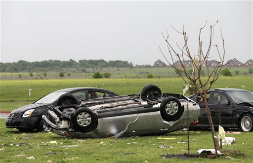 Vehicles damaged by a tornado are seen in the Dimaond Creek subdivision Tuesday, April 3, 2012, in Forney, Texas. Tornadoes tore through the Dallas area Tuesday, peeling roofs off homes, tossing big-rig trucks into the air and leaving flattened tractor trailers strewn along highways and parking lots. &#40;AP Photo&#47;Tony Gutierrez&#41; <span class=meta>(AP Photo&#47; Tony Gutierrez)</span>