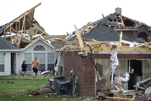 Persons walk through tornado damaged homes in the Diamond Creek subdivision Tuesday, April 3, 2012, in Forney, Texas. Tornadoes tore through the Dallas area Tuesday, peeling roofs off homes, tossing big-rig trucks into the air and leaving flattened tractor trailers strewn along highways and parking lots. &#40;AP Photo&#47;Tony Gutierrez&#41; <span class=meta>(AP Photo&#47; Tony Gutierrez)</span>
