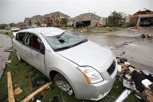 "<div class=""meta image-caption""><div class=""origin-logo origin-image ""><span></span></div><span class=""caption-text"">A tornado damaged vehicle sits in the Diamond Creek subdivision Tuesday, April 3, 2012, in Forney, Texas. Tornadoes tore through the Dallas area Tuesday, peeling roofs off homes, tossing big-rig trucks into the air and leaving flattened tractor trailers strewn along highways and parking lots. (AP Photo/Tony Gutierrez) (AP Photo/ Tony Gutierrez)</span></div>"