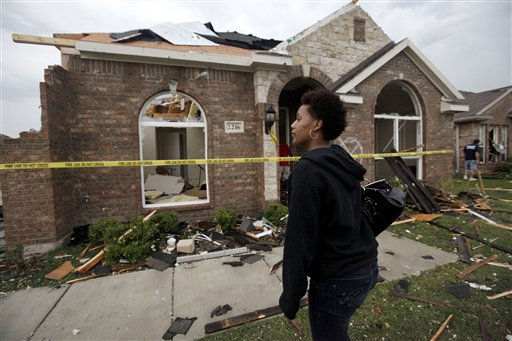 "<div class=""meta image-caption""><div class=""origin-logo origin-image ""><span></span></div><span class=""caption-text"">Cambrie Thornton stands in front of her tornado damaged home that emergency workers condemned Tuesday, April 3, 2012, in Forney, Texas. Tornadoes tore through the Dallas area Tuesday, peeling roofs off homes, tossing big-rig trucks into the air and leaving flattened tractor trailers strewn along highways and parking lots. (AP Photo/Tony Gutierrez) (AP Photo/ Tony Gutierrez)</span></div>"